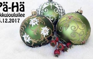 Vihreitä joulupalloja ja tekstiä